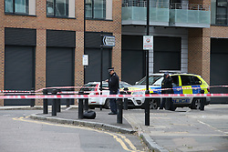 © Licensed to London News Pictures. 15/10/2015. London, UK. The scene on Scriven Street in Hackney, east London where a male police officer was shot during an authorised firearms operation by the Trident gang crime unit of the Metropolitian Police.  A man has been arrested at the scene. Photo credit: Peter Macdiarmid/LNP
