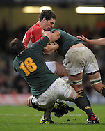 Photo © TOM DWYER / SECONDS LEFT IMAGES 2010 - Rugby Union - Invesco Perpetual Series - Wales v South Africa - 13/11/10 - Wales' George North is stopped in his tracks by South Africa's Flip van der Merwe (18) and Juan Smith- at Millennium Stadium Cardiff Wales UK -  All rights reserved