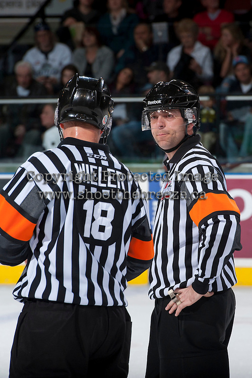KELOWNA, CANADA - APRIL 5: Reagan Vetter, referee, speaks to Nathan Wieler at the Kelowna Rockets on April 5, 2014 during Game 2 of the second round of WHL Playoffs at Prospera Place in Kelowna, British Columbia, Canada.   (Photo by Marissa Baecker/Getty Images)  *** Local Caption *** Reagan Vetter, Nathan Wieler; referee;