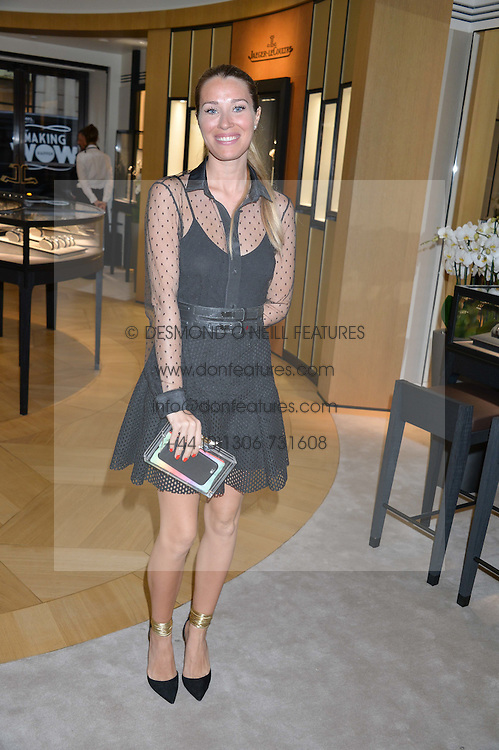 COSIMA VESEY at a private view of photographs by Astrid Munoz entitled Unbridled Synchrony hosted by  Jaeger-LeCoultre at their boutique at 13 Old Bond Street, London on 13th July 2015.