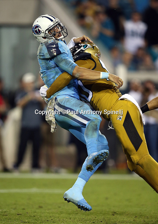 Tennessee Titans quarterback Marcus Mariota (8) is shaken up as he gets hit and slammed to the turf by Jacksonville Jaguars defensive end Andre Branch (90) after Mariota throws a pass with about two minutes left in the fourth quarter during the 2015 week 11 regular season NFL football game against the Jacksonville Jaguars on Thursday, Nov. 19, 2015 in Jacksonville, Fla. The Jaguars won the game 19-13. (©Paul Anthony Spinelli)