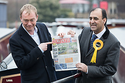 "© Licensed to London News Pictures . 14/02/2017 . Stoke-on-Trent , UK . Lib Dem leader TIM FARRON joins candidate DR ZULFIQAR ALI , pictured holding a copy of Towpath Talk (headline "" Spring cruising under threat "" ), whilst campaigning at Festival Park Marina in Etruria , in the Stoke Central by-election . Photo credit : Joel Goodman/LNP"