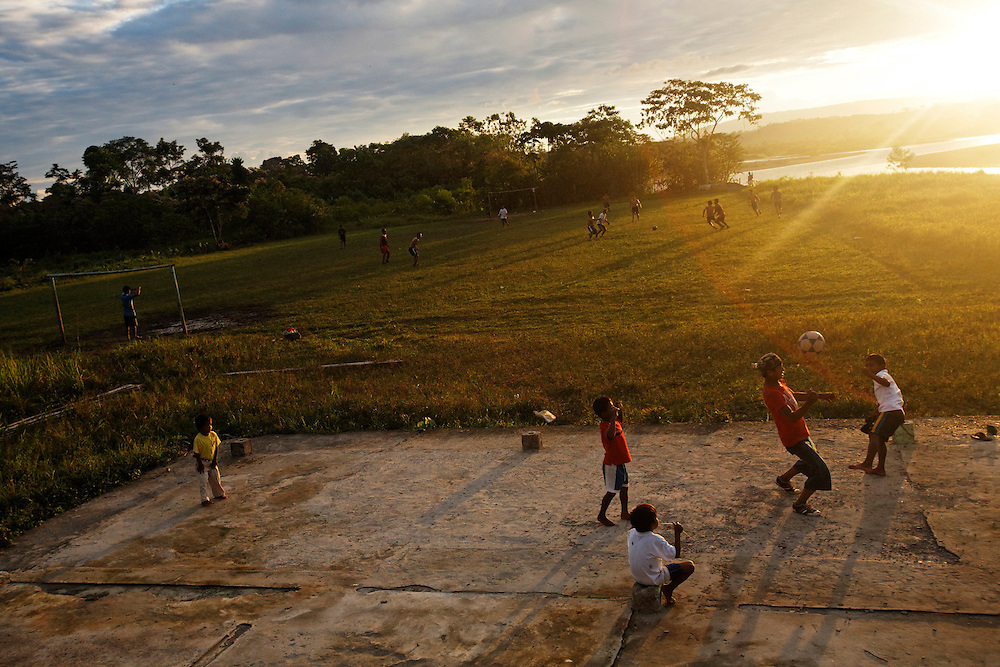 People play soccer in San Pedro Sumino in August of 2009.   San Pedro is a Quichua (indigenous) community located on the Napo River.   Many of the houses located along the river can only be reached by canoe and the residents live in isolation.   The people hunt, grow crops, such as corn and yuca, and fish in the Napo river.
