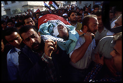Palestinians carry the body of Hani Marzouk, 38, through the streets of the West-bank city of Jenin. Marzouk, was wounded during clashes with Israeli soldiers in Nablus and died the following day. He was brought to his hometown of Jenin for his funeral approximately 100 kilometers North of Jerusalem. (Photo © Jock Fistick)
