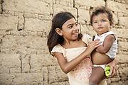 A girl holds her younger sibling in San Esteban, Honduras on Thursday April 25, 2013.