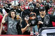 Oakland Raiders fans ham it up during the San Francisco 49ers NFL week 9 regular season football game against the Oakland Raiders on Thursday, Nov. 1, 2018 in Santa Clara, Calif. The 49ers won the game 34-3. (©Paul Anthony Spinelli)
