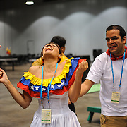 World Choir Games participants from around the globe, including Hong Kong, Venezuela and Namibia, enjoy a break from the intense choir competitions on July 5, 2012. The participant lounge at Duke Energy Convention Center allows choirs to meet one another, play games, dance and, of course, sing.