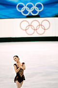 U.S. figure skater Sasha Cohen starts her routine under the Olympic rings during the Women's Free Skating Program at the Palavela ice arena on Thursday February 23, 2006 in Turin, Italy at the 2006 Winter Olympics. U.S. figure skater Sasha Cohen led all skaters going into the evening and finished the night with a silver medal with a total score of 183.36. Japan's Shizuka Arakawa won the gold with a score of 191.34 and Russia's Irina Slutskaya won the bronze with a score of 181.44..(Photo by Marc Piscotty / © 2006)