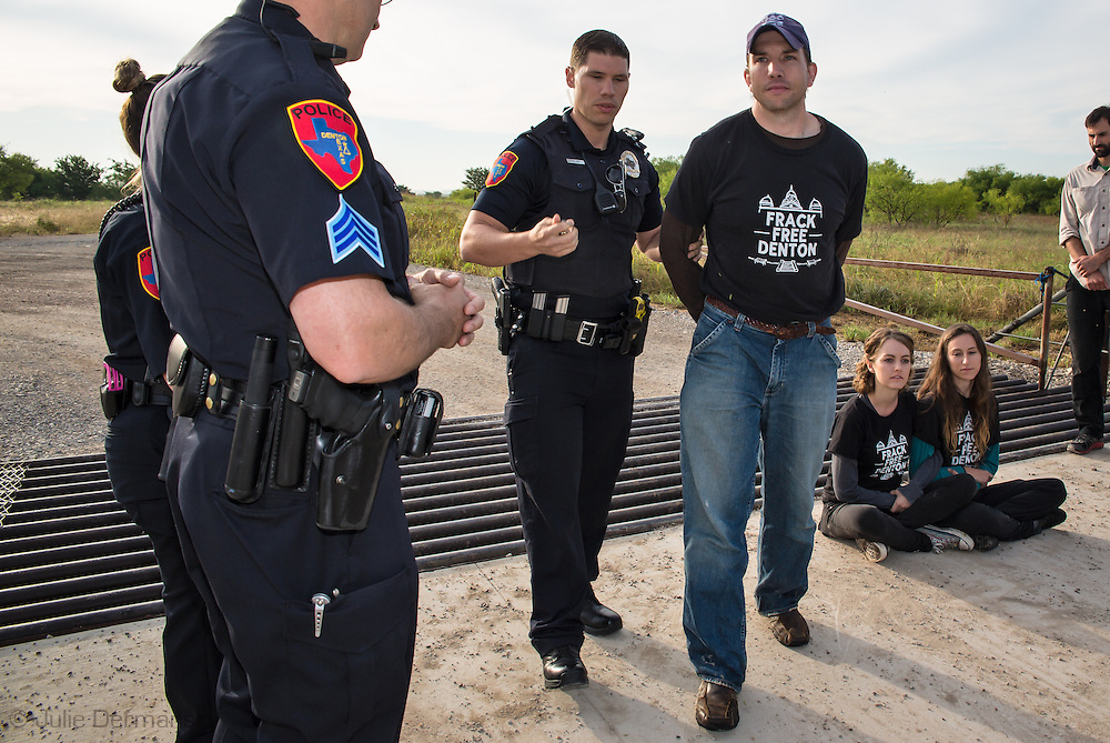 June 1, 2015, Denton, Texas, Adam Briggle, president of the Denton Drilling Awareness Group, arrested for trespassing at a Vantage frack site. Three members of the Denton Drilling Awareness Group were arrested when they refused to move away from the entrance to a fracking site where work began on June 1 despite a fracking ban the citizens of Denton voted for seven months ago.  Texas Governor Greg Abbott signed legislation, HB 40, that prohibits cities and towns in Texas from banning fracking