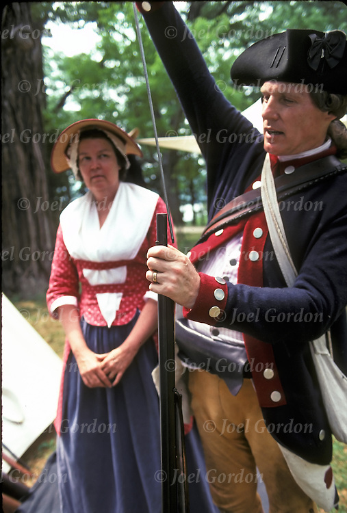 4th of July reinactment of American Revolution War and demonstrations..Informative Speaker dressed in revolationary war outfit giving demonstration in New York Upstate park..releases 443, 444