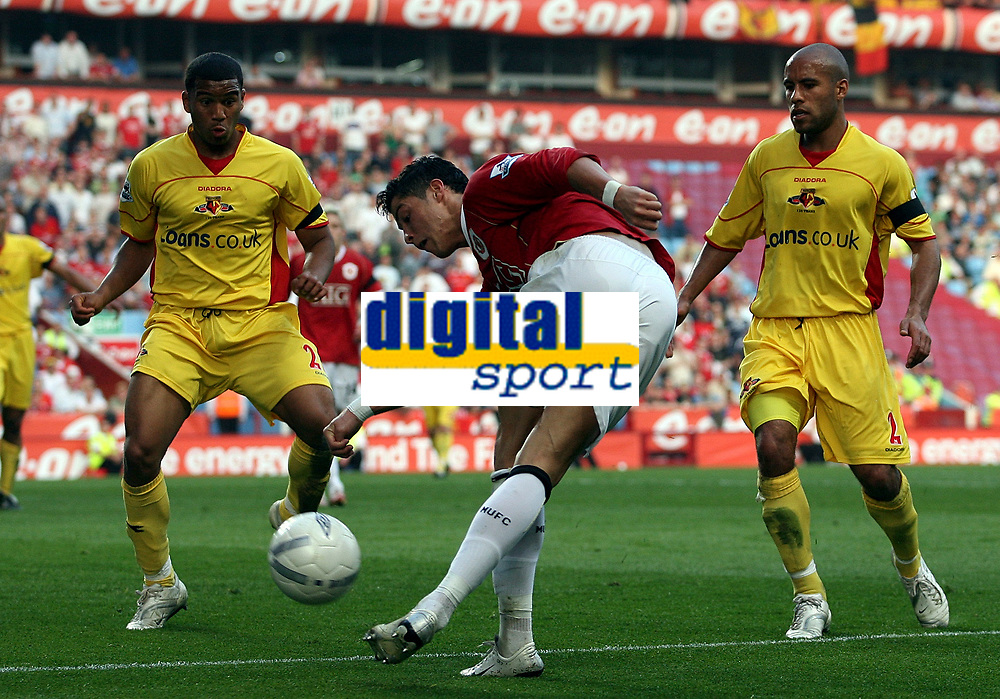 Photo: Paul Thomas.<br /> Watford v Manchester United. The FA Cup, Semi Final. 14/04/2007.<br /> <br /> Cristiano Ronaldo (C) of Utd does a reserve behind leg cross in front of the Watford pair Adrian Mariappa (L) and James Chambers (R) who just watch the MAGIC.