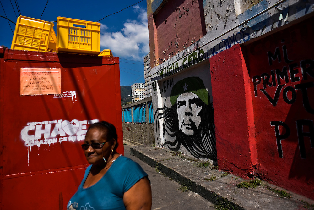 A woman walks past a housing project painted with a mural of Che Guevara in 23 de Enero, a slum that is notorious as Chavez's fiercest stronghold in Caracas, Venezuela on Tuesday, January 15, 2013.