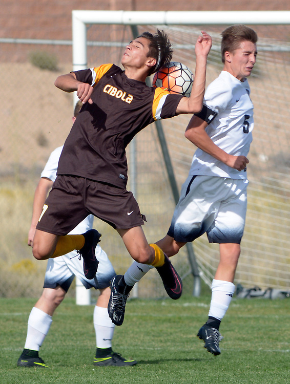 gbs092816l/SPORTS -- Cibola's Chance Ford, left, and Volcano Vista's Larsen Rogers jump for a header in the first half of the game at Volcano Vista on Wednesday, September 28, 2016. (Greg Sorber/Albuquerque Journal)