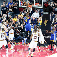 09 June 2017: Golden State Warriors forward Kevin Durant (35) goes for the dunk on Cleveland Cavaliers guard Kyrie Irving (2) during the Cleveland Cavaliers 137-11 victory over the Golden State Warriors, in game 4 of the 2017 NBA Finals, at  the Quicken Loans Arena, Cleveland, Ohio, USA.
