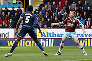 Queens Park Rangers defender Nedum Onuoha (5)  watches as Burnley midfielder Scott Arfield (37)  waits for the ball to come down during the Sky Bet Championship match between Burnley and Queens Park Rangers at Turf Moor, Burnley, England on 2 May 2016. Photo by Simon Davies.