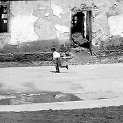Kosovo, kids playing football outside during school time.
