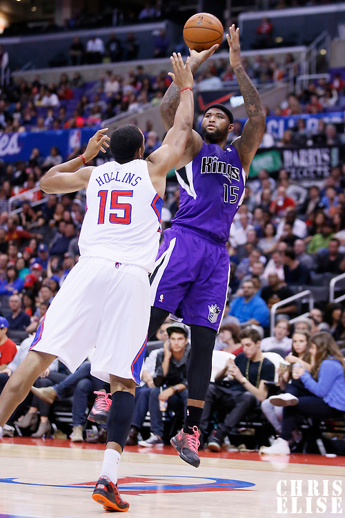 25 October 2013: Sacramento Kings center DeMarcus Cousins (15) takes a jumpshot over Los Angeles Clippers center Ryan Hollins (15) during the Sacramento Kings 110-100 victory over the Los Angeles Clippers at the Staples Center, Los Angeles, California, USA.