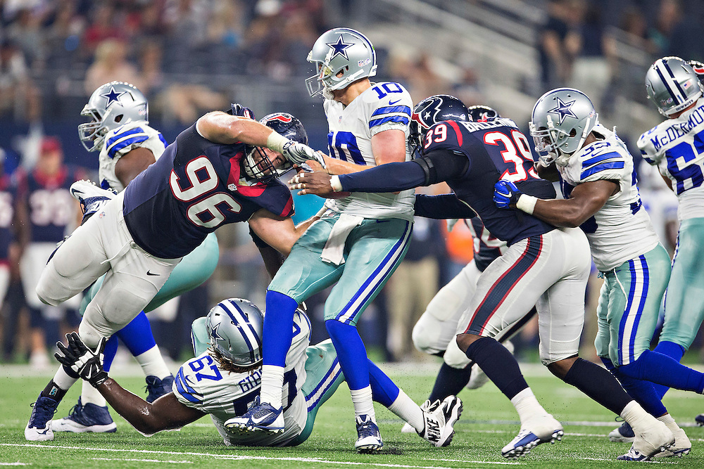 ARLINGTON, TX - SEPTEMBER 3:  Dustin Vaughan #10 of the Dallas Cowboys is sacked by Dan Pettinato #96 and Lonnie Ballentine #39 of the Houston Texans during a preseason game at AT&T Stadium on September 3, 2015 in Arlington, Texas.  (Photo by Wesley Hitt/Getty Images) *** Local Caption *** Dustin Vaughan; Dan Pettinato; Lonnie Ballentine