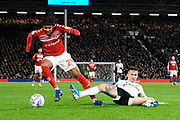 Djed Spence (29) of Middlesbrough is challenged by Joe Bryan (23) of Fulham during the EFL Sky Bet Championship match between Fulham and Middlesbrough at Craven Cottage, London, England on 17 January 2020.