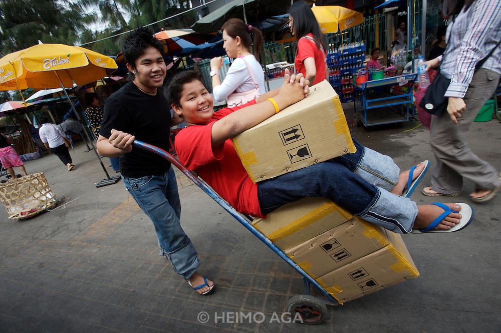 Chatuchak Sunday Market. Boys having fun.