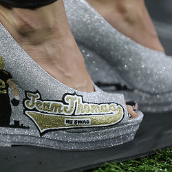 Jan 13, 2019; New Orleans, LA, USA; Ebbie Thomas, wife of wife of New Orleans Saints running backs coach Joel Thomas wears special Saints themed footwear before a NFC Divisional playoff football game between the Saints and the Philadelphia Eagles at Mercedes-Benz Superdome. Ebbie Thomas is the . Mandatory Credit: Derick E. Hingle-USA TODAY Sports