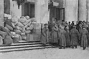 Bags of flour ready to be distributed to the poor, outside the Palace of Tauride (seat of the Provisional Government after the February Revolution) in Petrograd, later St Petersburg, during the Russian Revolution, photograph by Daily Mirror, published in L'Illustration no.3867, 14th April 1917. Picture by Manuel Cohen
