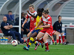 Arsenal Ladies' Danielle Carter is closed down by Bristol Academy Women's Loren Dykes - Photo mandatory by-line: Dougie Allward/JMP - Mobile: 07966 386802 - 20/09/2014 - SPORT - FOOTBALL - Bristol - SGS Wise Campus - BAWFC v Arsenal Ladies - FA Womens Super League
