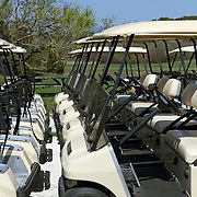 Golf Carts lined up ready for use in North Truro, Cape Cod, Massachusetts, USA