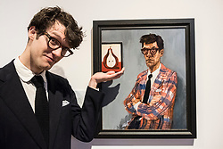 Edinburgh, Scotland, United Kingdom. 14 December, 2017. <br /> Artist Ross McAuley  poses beside his painting a Self Portrait with Pear at the exhibition of BP Portrait Award 2017.<br /> The BP Portrait Award 2017 opens at the Scottish National Portrait Gallery on 16 December 2017.