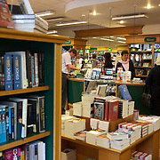 Customers browse the University Bookshop in Great King Street, Dunedin, New Zealand. 25th March  2011. Photo Tim Clayton