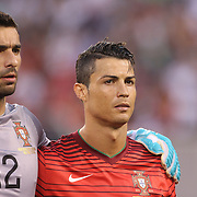 Cristiano Ronaldo, (right), and goalkeeper Rui Patricio Portugal, during National Anthems before the Portugal V Ireland International Friendly match in preparation for the 2014 FIFA World Cup in Brazil. MetLife Stadium, Rutherford, New Jersey, USA. 10th June 2014. Photo Tim Clayton