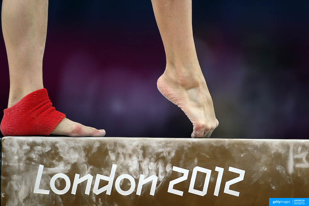 A study of gymnasts feet on the balance beam. . One of the most challenging disciplines of the Olympic games sees young gymnasts performing amazing acrobatic feats and landing their somersaults and back flips on a beam with a width of 10cm (4in) standing 124cm (4.07ft) from the ground. Women's Artistic Gymnastics podium training at North Greenwich Arena during the London 2012 Olympic games preparation at the London Olympics. London, UK. 26th July 2012. Photo Tim Clayton