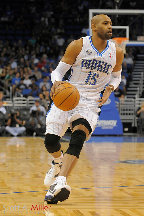 Oct 20, 2010; Orlando, FL, USA; Orlando Magic shooting guard Vince Carter (15) brings the ball upcourt during the Magic's game against the Dallas Mavericks at the Amway Center. ©2010 Scott A. Miller