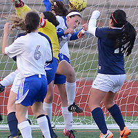 Laura Stoecker/lstoecker@dailyherald.com<br /> Rosary's Anna Sheen heads the ball away from the Royals' goal with West Aurora's Yulissa Espino ready to fight for it in the first half on Wednesday, April 16.