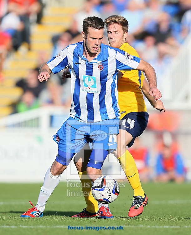 Picture by Paul Gaythorpe/Focus Images Ltd +447771 871632<br /> 28/09/2013<br /> Andy Monkhouse of Hartlepool United and Asa Hall of Oxford United during the Sky Bet League 2 match at Victoria Park, Hartlepool.