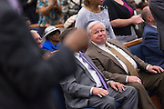 North Charleston Mayor Keith Summey listens to Rev. Al Sharpton addresses a healing service at Charity Missionary Baptist Church April 12, 2015 in North Charleston, South Carolina. Sharpton spoke following the recent fatal shooting of unarmed motorist Walter Scott police and thanked the Mayor and Police Chief for doing the right thing in charging the officer with murder.