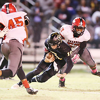 Pontotoc quarterback Justin Carter gets sacked late in the second quarter after several penalites backed up the Warriors for a long third down conversion.