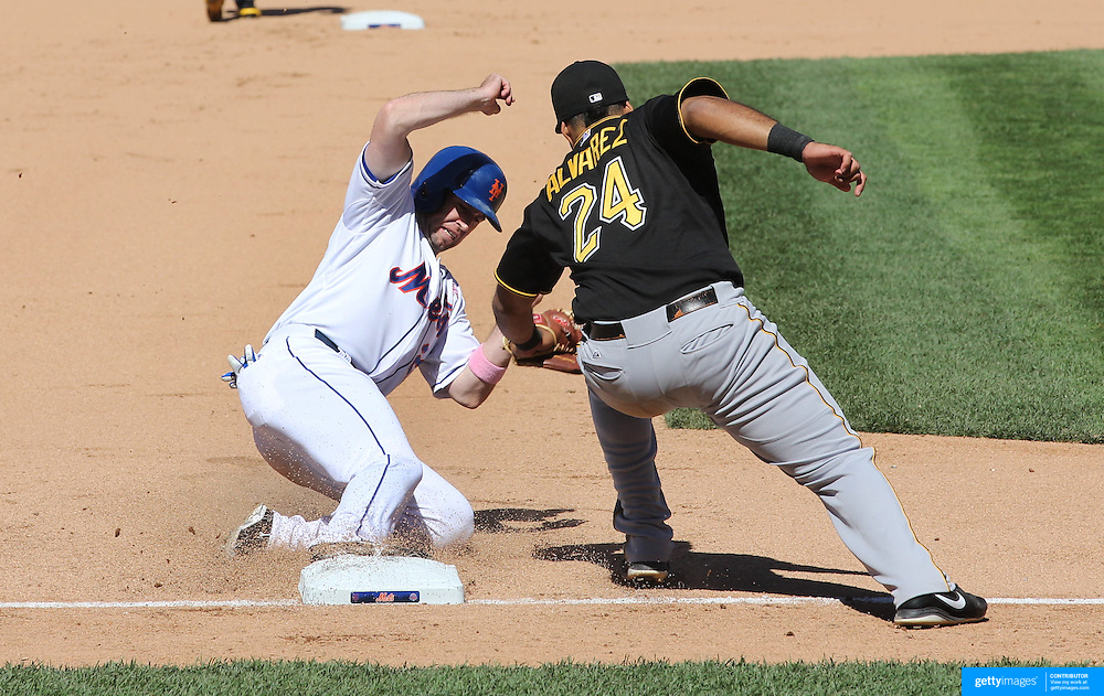 Mike Baxter steals third base as Pirates third baseman Pedro Alvarez  attempts to apply the tag during the New York Mets V Pittsburgh Pirates Baseball game at Citi Field, Queens, New York. USA. 12th May 2013. Photo Tim Clayton