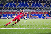 Bolton Wanderers goalkeeper Matthew Alexander save the penalty from Bradford City defender Paudie O'Connori in the penalty shoot-out during the EFL Trophy match between Bolton Wanderers and Bradford City at the University of  Bolton Stadium, Bolton, England on 3 September 2019.
