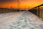 Quay covered in snow at sunrise