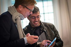27 October 2018, Stockholm, Sweden: Erik Lysén, Church of Sweden, in conversation with Saeed Alnahhal, a Syrian refugee who's received support through the Goda Grannar project. On Saturday, participants at the 2018 Assembly of the ACT Alliance visited the Stockholm Grand Mosque and the Katarina Parish of Church of Sweden to learn about their interreligious Goda Grannar ('Good Neighbours') project, through which they offer support to refugees and newly arrived people in Sweden.