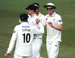 Craig Miles of Gloucestershire celebrates with Jack Taylor of Gloucestershire after catching out Rory Kleinveldt of Northamptonshire - Photo mandatory by-line: Dougie Allward/JMP - Mobile: 07966 386802 - 08/07/2015 - SPORT - Cricket - Cheltenham - Cheltenham College - LV=County Championship 2