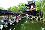 "Yu Garden or Yuyuen ""Happy Garden""  is an extensive Chinese garden located beside the City God Temple in Shanghai. Yu Garden was first conceived in 1559 during the Ming Dynasty by Pan Yunduan as a comfort for his father minister Pan En, in his old age. The garden was the largest of its era but eventually its expense helped ruin the Pan family. The garden was opened to the public in 1961 and then declared a national monument in 1982."