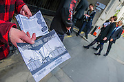 Environmental protestors lobby Drax shareholders as they arrive for its Annual General Meeting. Grocers hall, Bank, London, UK 23 April 2014.