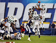 New York Jets safety Kerry Rhodes (25) and wide receiver Jerricho Cotchery (89) try to outleap San Diego Chargers wide receiver Kassim Osgood (81) on a key onside kick late in the fourth quarter during the AFC Divisional Playoff game against the San Diego Chargers, January 17, 2010 in San Diego, California. The Jets recovered the kick and eventually won the game 17-14. ©Paul Anthony Spinelli