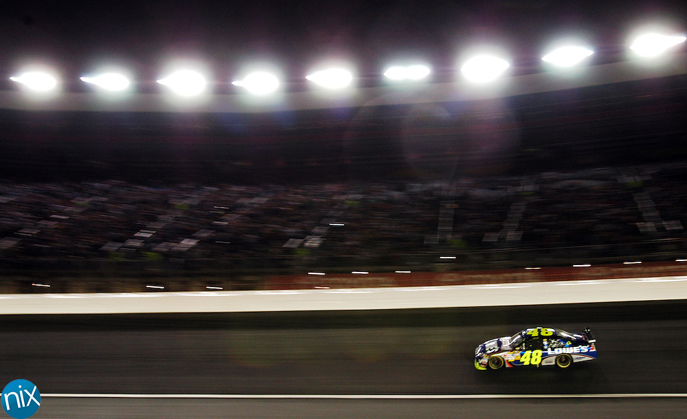 Jimmie Johnson leads early laps of the Bank of America 500 at Lowe's Motor Speedway Saturday, Oct. 11, 2008. (photo by James Nix)