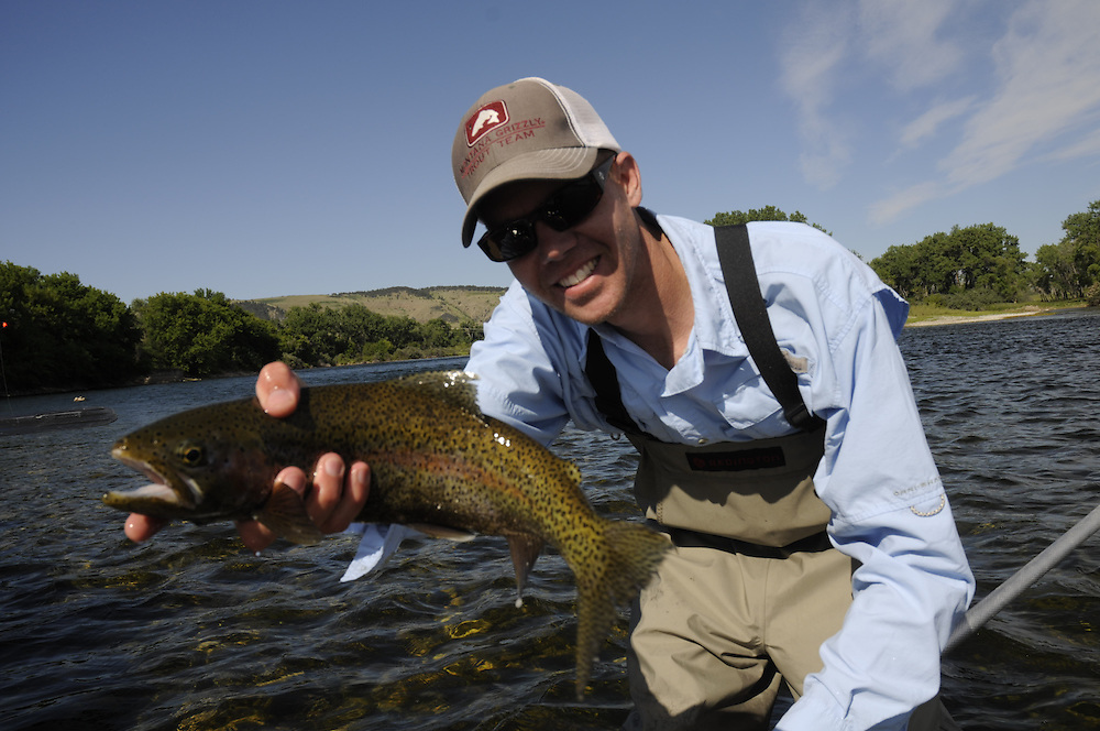 Angler with rainbow trout in hand