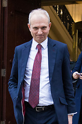 © Licensed to London News Pictures. 15/01/2018. London, UK. Minister for the Cabinet Office David Lidington leaves Four Millbank after giving media interviews over the collapse of construction firm Carillion. Lidington has said the Government will pay Carillion workers on public sector contracts. Photo credit: Rob Pinney/LNP