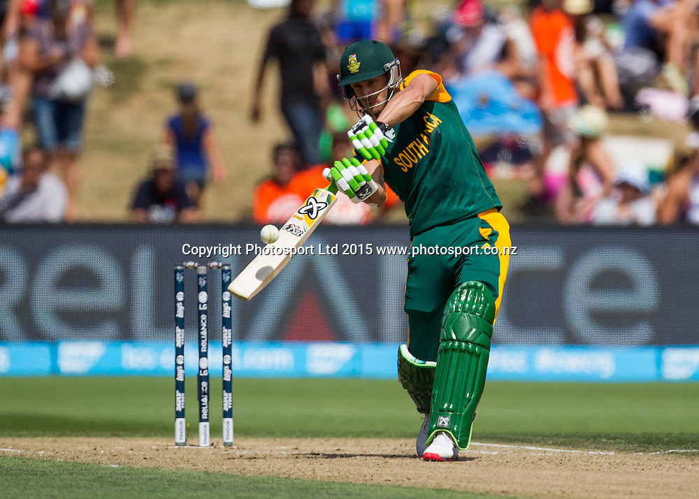 South Africa's Faf du Plessis hits a six during the ICC Cricket World Cup match - South Africa v Zimbabwe at Seddon Park, Hamilton, New Zealand on Sunday 15 February 2015.  Photo:  Bruce Lim / www.photosport.co.nz