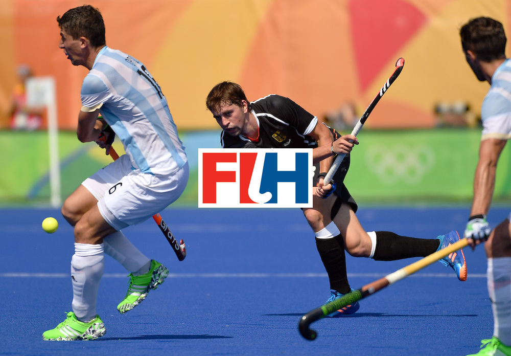 Argentina's Ignacio Ortiz (L) vies with Germany's Linus Butt during the men's quarterfinal field hockey Argentina vs Germany match of the Rio 2016 Olympics Games at the Olympic Hockey Centre in Rio de Janeiro on August 16, 2016.  / AFP / Pascal GUYOT        (Photo credit should read PASCAL GUYOT/AFP/Getty Images)